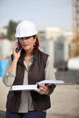 Businesswoman supervising a construction site — Stock Photo
