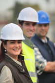 Three construction colleagues on-site — Stock Photo