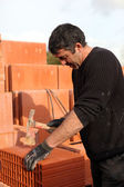 Builder shaping a brick — Stock Photo