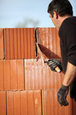 Mason cementing between bricks — Stock Photo