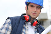 Foreman with ear defenders — Stock Photo