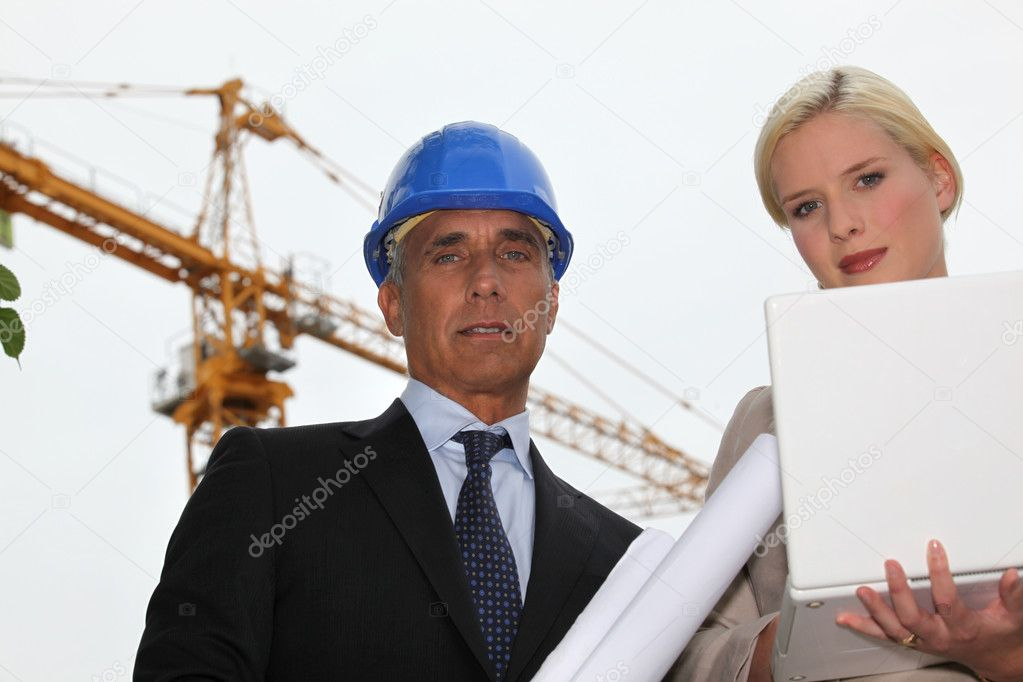 Female architect with foreman in construction site — Stock Photo #9816972