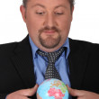Man with globe — Stock Photo
