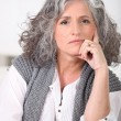 Stock Photo: Senior womwith long grey hair