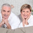 Mature couple in bed — Stock Photo #9823572