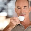 Elderly man drinking coffee — Stock Photo #9823808