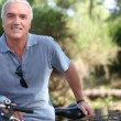 Senior man on a bicycle — Stock Photo