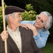 Mature couple in garden — Stock Photo #9824691