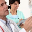 Doctor and nurse on a professional meeting — Stock Photo