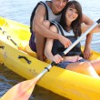 Stock Photo: Couple in canoe