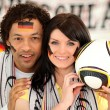 Couple supporting the German football team — ストック写真