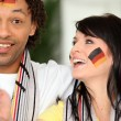 Stock Photo: Couple supporting Germfootball team