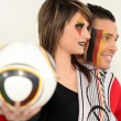 Young couple supporting German soccer — Stock Photo