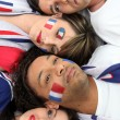 Four French sports fans laying together — Stock Photo