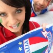 Couple supporting the Italian soccer team - Stock Photo