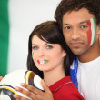 Stock Photo: Couple supporting Italifootball team