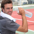 Tennis player drinking water — Stockfoto