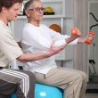Senior women in rehabilitation class - 