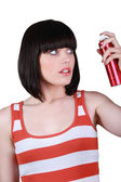 Sophisticated woman with hairspray — Stock Photo