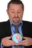 Man with globe — Stock Photo