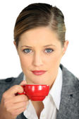 Woman with red coffee cup — Stock Photo