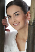 Brunette portrait of bamboo reeds — Stock Photo