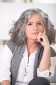 Senior woman with long grey hair — Stock Photo