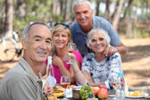 Older eating in a field — Stock Photo