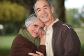 Mature couple embracing — Stock Photo