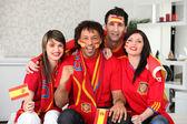 Four Spanish sports fans — Stock Photo