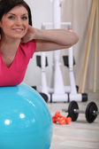 Woman using a gym ball — Foto de Stock