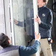 Stock Photo: Laborers installing window