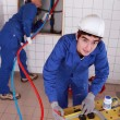 Royalty-Free Stock Photo: Plumbers at work