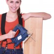 Woman laying wood flooring — Stock Photo #9955478