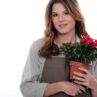 Florist stood with plant and rake — Stock Photo
