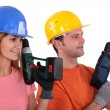 Tradespeople holding power tools — Stok fotoğraf
