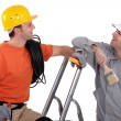 Stock Photo: House painter and electricilaughing