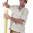 Carpenter with a hammer — Stock Photo