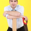 Businessman stood with hand-saw — Stock Photo #9958317