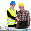 Architect and builder with laptop — Stok fotoğraf