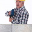 Foto Stock: Tradesmusing power tool