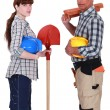 Male and female roofers stood together — Foto Stock
