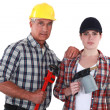Tradespeople holding tools - Stock Photo