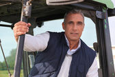 Farmer sat in his tractor — Stock Photo