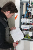 Electrician with sketch of electrical panel — Stock Photo