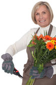 Middle-aged female florist — Stock Photo