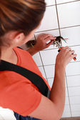 Electrician fixing electrical wiring — Stock Photo
