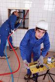 Fontaneros en el trabajo — Foto de Stock
