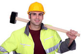 Worker with a sledgehammer — Stock Photo
