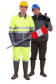Full-length portrait of bricklayer and carpenter — Stock Photo